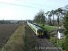 2723 + 2726 + 2711 + 2712 pass the former station at Milford, Co. Carlow with the 0925 Waterford - Connolly G.A.A. Special. Tues 17.03.09