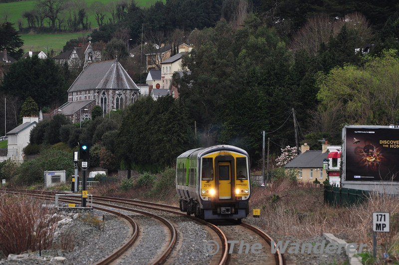 The Hybrid 2716 + 2609 passes Glounthaune Village with the 1015 Cork - Midleton. Sat 10.03.12