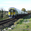 2707 + 2708 + 2718 + 2717 passes Yellow Quarry Crossing with the 1100 Tralee - Cork. Sun 05.11.06.