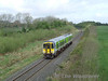 2706 + 2705 pass Woodfarm with the 0955 Limerick - Limerick Junction. Mon 20.04.09
