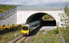 The 2700 Class DMU is somewhat dwarfed by the M8 Motorway overbridge near Cahir.  Sat 07.04.12