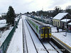 Much of Ireland experienced snowfall on Friday 1st Feb 2008. 2706 + 2705 + 2712 + 2711 are seen at Rathmore while working the 13.25 Mallow - Tralee service as a local staff member clear recently fallen snow from the platform. Fri 01.02.08