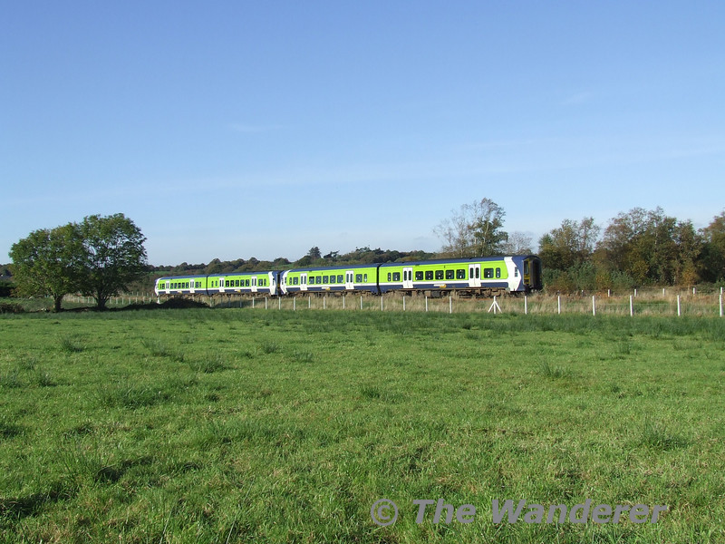 2714 + 2713 + 2721 + 2720 passes the townland of Minish with the 1155 Tralee - Mallow. Sat 04.11.06. NOTE: Photo taken with permission of landowner.