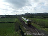 2715 + 2724 at Woodfarm bridge, near Dromkeen with the 0943 Limerick Jct - Limerick. Mon 20.04.09
