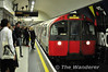 A Piccadilly Line train arrives at the Eastbound Platform at Leicester Square.  Sun 15.05.11