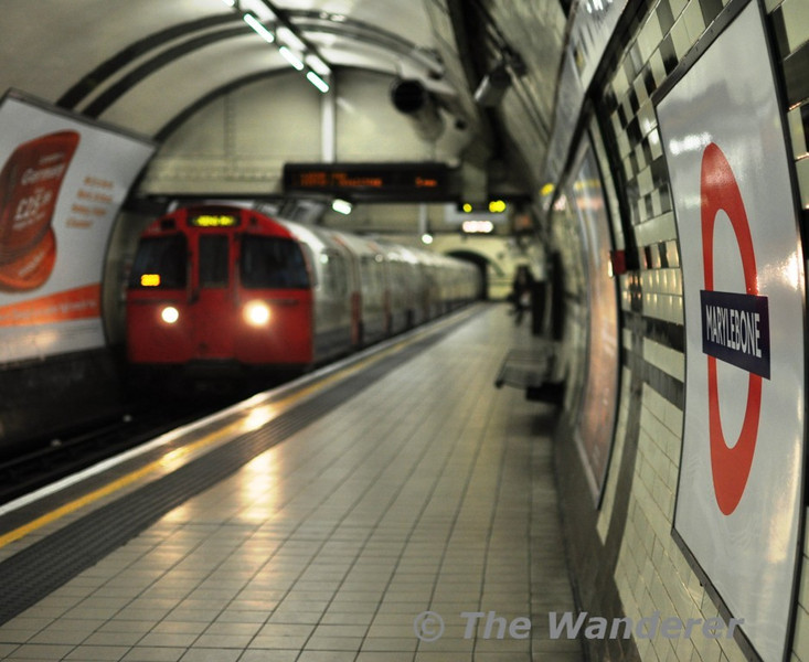 A deserted Marylebone Underground Station as a Bakerloo line for Queens Park arrives. Sun 16.05.10