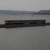 459 works the 1442 Belfast Central / Larne Harbour seen crossing the causeway at Glynn 060910