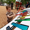Mason Cooper, 5, from Ayer plays the new xylophone at the new playground at Wallis Park in Lunenburg. SENTINEL & ENTERPRISE/JOHN LOVE