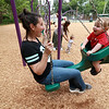 Lauren Beland and her son Benjamin Beland, 1, from Leominster have fun on one of the swings at the new playground at Wallis Park in Lunenburg. SENTINEL & ENTERPRISE/JOHN LOVE