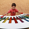 Dylan Kaddy, 4, from Fitchburg, plays the new xylophone at the new playground at Wallis Park in Lunenburg. SENTINEL & ENTERPRISE/JOHN LOVE