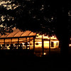The sun set behind this greenhouse at Gove Farm in Leominster on Tuesday night. SENTINEL & ENTERPIRSE/JOHN LOVE