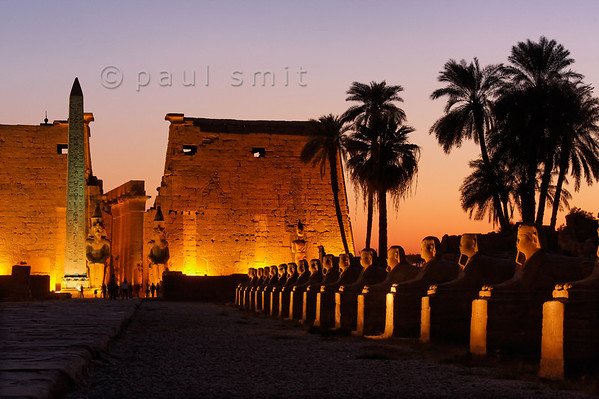 13-calendar-egypt-luxor  Ancient avenue, lined with sfinxes, connecting Luxor Temple (pictured) with Karnak Temple at 3 km. It was the route taken by a joyous procession during the Opet Festival, a yearly feast of rebirth and re-coronation of the pharao during the New Kingdom. Photo Paul Smit.