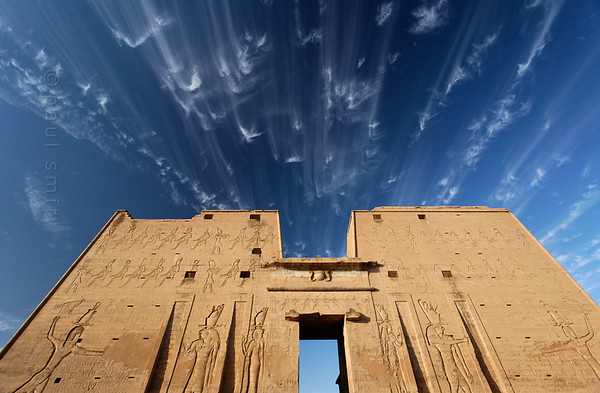 22-egypt-edfu  What does the future hold for Egypt? Is a storm brewing? A new era of military dictatorship, this time under Sisi instead of Mubarak? Or is the wind of democracy still blowing? Nobody knows what lies ahead, waiting at the other side of the gate.  The pylon of the Horus Temple at Edfu. Photo Paul Smit.