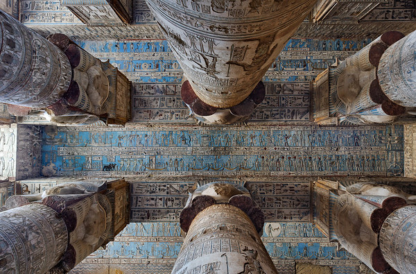 06-calendar-egypt-dendera  Columns and ceiling of the outer hypostyle hall in the Hathor Temple at Dendera.  The ceiling has recently been cleaned in a careful way that removed hundreds of years of black soot, without harming the ancient paint underneath. Photo Mick Palarczyk.