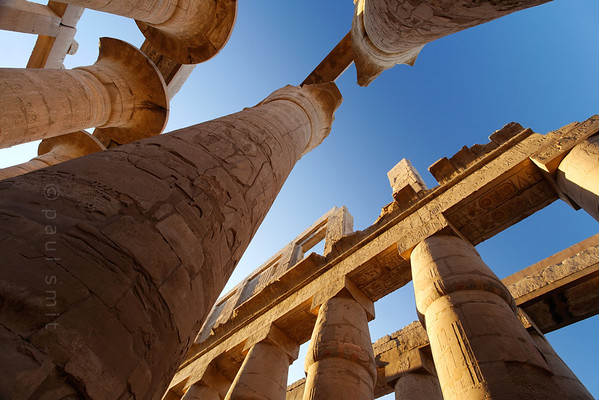 11-calendar-egypt-karnak  Columns and architraves in the Great Hypostyle Hall of Karnak. The hall was built in the reign of Amenhotep III and decorated under Seti I and Ramses II. Photo Paul Smit.