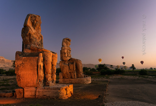 19-calendar-egypt-memnon  The Colossi of Memnon are two 18 meters high statues of Amenhotep III that fronted his now largely destroyed mortuary temple on the west bank in Luxor. Photo Mick Palarczyk.
