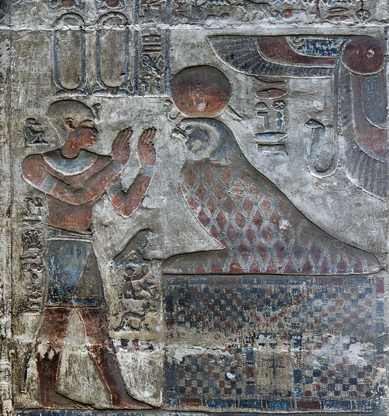[EGYPT 29624] 'Ptolemaic Pharaoh and Osiris in Dendera.'  A relief in the Hathor Temple of Dendera shows an unidentified Ptolemaic Pharaoh (his cartouches above him are empty) worshipping Osiris in the form of a mummified falcon. The relief can be found in the Chapel of Sokar, which is one of the shrines located to the east of the central sanctuary. This part of the  Dendera Temple was built during the later Ptolemaic period (first century BC). Photo Paul Smit.