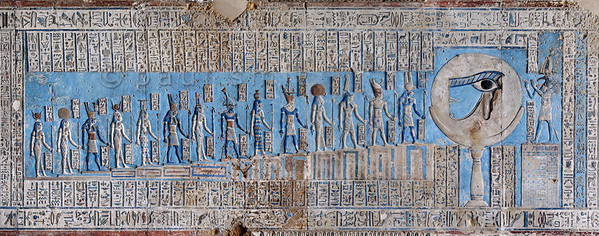 "[EGYPT 29565] 'The waxing moon and the Eye of Horus at Dendera.'  	This forceful image of the moon on a pillar, decorated with the ""healed eye"" of Horus, can be found on the astronomical ceiling of the outer hypostyle hall in the Hathor Temple at Dendera. The astronomical ceiling consists of seven separate strips but here we are looking at a detail of the FIRST STRIP WEST from centre. The deities in this picture form part of a panel that deals with the waxing moon and which is located at the middle of the strip. According to Egyptian mythology Horus lost his eye during a battle with Seth (the murderer of his father Osiris) and the eye (called 'Wadjet') was subsequently healed by Thoth, who is portrayed at the right-hand side of the picture.	 The destruction and healing of the eye was symbolically coupled by the ancient Egyptians to the waning and waxing of the moon. To the left of the moon are 14 stairs with gods who refer to the 14 days leading up to the full ""healed"" moon. From right to left they are Min (1), Atum (2), Shu (3), Tefnut (4), Geb (5), Nut (6), Osiris (7), Isis (8), Horus (9), Nephtys (10), Hathor (11), Horus (12), Tanenet (13) and Iunit (14). For an overview of the entire strip see picture 29561. This part of the Dendera Temple was built during the Roman period (first century AD). Photo Paul Smit."