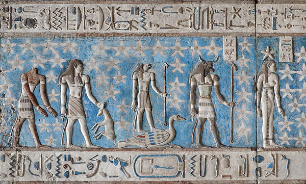 [EGYPT 29535] 'Bull-headed planet Saturn at Dendera.'  	A bull-headed god named 'Horus-Bull' personifies the planet Saturn on the astronomical ceiling in the outer hypostyle hall of the Hathor Temple at Dendera. The ceiling consists of seven separate strips but here we are looking at a detail of the upper register of the EASTERNMOST STRIP. The standing woman with a star on her head is the goddess of the first hour of the night. The headless human body personifies a star or constellation north of the Ecliptic. Also north of the Ecliptic is the constellation made up of an human-headed-god holding an oryx by the horns. North of the ecliptic as well is the falcon-headed god standing on a goose. The astronomical location of these three heavenly bodies is known from the famous round zodiac of Dendera which is kept in the Louvre.	 For an overview of this ceiling strip see picture 29526. This part of the Dendera Temple was built during the Roman period (first century AD). Photo Mick Palarczyk.