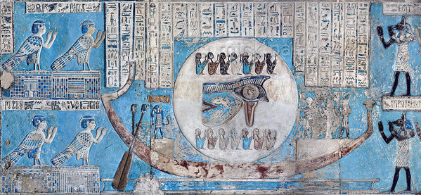 "[EGYPT 29569] 'The waning moon and the Eye of Horus at Dendera.'  	This image of the moon on a boat, decorated with the ""healed eye"" of Horus, can be found on the astronomical ceiling of the outer hypostyle hall in the Hathor Temple at Dendera. The astronomical ceiling consists of seven separate strips but here we are looking at a detail of the FIRST STRIP WEST from centre. The moon eye is part of a panel that deals with the waning moon and which is located at the northern end of the strip. According to Egyptian mythology Horus lost his eye during a battle with Seth (the murderer of his father Osiris) and the eye (called 'Wadjet') was subsequently healed by Thoth. The destruction and healing of the eye was symbolically coupled by the ancient Egyptians to the waning and waxing of the moon. In this depiction of the eye the fourteen sitting deities above and below it personify the fourteen days of the waning moon.	 The four human-headed birds on the left are (according to the caption above them) the ""Souls of the sixth day of the month"". The caption further mentions that they honour the moon when it begins to renew its cycle on the 15th day of the month (and starts waning). For an overview of the entire ceiling strip see picture 29561. This part of the Dendera Temple was built during the Roman period (first century AD). Photo Mick Palarczyk."