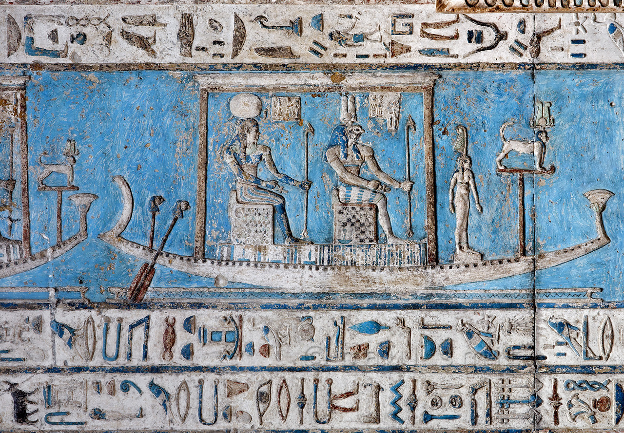 [EGYPT 29545] 'Harsomptus and Ra sailing across the sky at Dendera.'  Seated on thrones, the sun god Ra (crowned by a disc) and Harsomptus are sailing across the sky on the astronomical ceiling in the outer hypostyle hall of the Hathor Temple at Dendera. The ceiling consists of seven separate strips but here we are looking at a detail of the upper register of the SECOND STRIP EAST from centre. For an overview of this ceiling strip see picture 29539. This part of the Dendera Temple was built during the Roman period (first century AD). Photo Paul Smit.