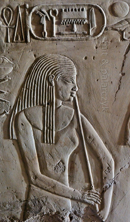 """[EGYPT 29402] 'Flutist in Kheruef's tomb at Luxor.'  This relief detail in the tomb of Kheruef shows a flutist who performs on the occasion of the First Jubilee (heb sed) festival of Amenhotep III, whose cartouche can be seen at the top of the picture. Kheruef was steward of Queen Tiy, the wife of Amenhotep III, and played an important role during festivals. His (unfinished) tomb (TT 192) can be found in the Asasif Necropolis on the Westbank at Luxor. It is one of the socalled """"Tombs of the Nobles"""". Photo Mick Palarczyk and Paul Smit."""