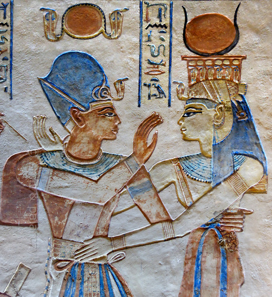 [EGYPT 29414] 'Ramses III and Isis in the tomb of Amenherkhepshef.'  	This coloured relief in the tomb of Amenherkhepshef shows Ramses III in an embrace with the goddess Isis. Ramses is wearing the blue khepresh crown while Isis' blue wig is topped by a vulture headdress and the sun disc between cows horns. Amenherkhepshef was a royal scribe, commander of the cavalry and son of Ramses III. His tomb (QV 55) can be found in the Valley of the Queens on the Westbank at Luxor. Photo Mick Palarczyk and Paul Smit.