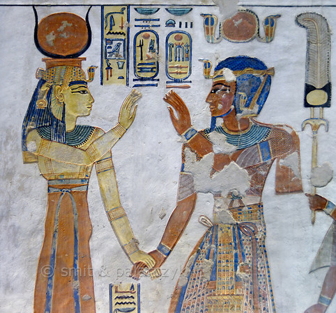[EGYPT 29415] 'Ramses III and Hathor in the tomb of Amenherkhepshef.'  This coloured relief in the tomb of Amenherkhepshef shows Ramses III holding hands with the goddess Hathor. Amenherkhepshef was a royal scribe, commander of the cavalry and son of Ramses III. His tomb (QV 55) can be found in the Valley of the Queens on the Westbank at Luxor. Photo Mick Palarczyk and Paul Smit.