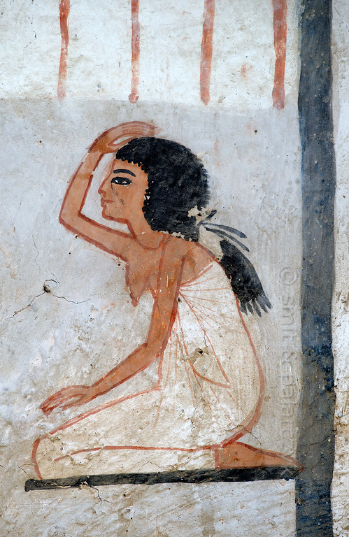 "[EGYPT 29372] 'Mourning woman in Roy's tomb at Luxor.'  	A mural detail in the tomb of Roy shows a kneeling woman who makes a gesture of mourning. Roy was an 18th dynasty royal scribe during the reign of Horemheb. His tomb (TT 255) can be found in the Necropolis of Dra Abu el-Naga on the Westbank at Luxor. It is one of the socalled ""Tombs of the Nobles"". Photo Mick Palarczyk and Paul Smit."