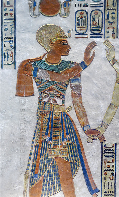 [EGYPT 29410] 'Ramses III in the tomb of Amenherkhepshef.'  	This coloured relief portrays Ramses III in the tomb which was made for his son prince Amenherkhepshef. Ramses is wearing a sumptuous loincloth adorned with feathers and completed with an embroidered corselet. His head is covered by a helmet decorated with golden rings The tomb (QV 55), in which Amenherkhepshef was actually never buried, can be found in the Valley of the Queens on the Westbank at Luxor. Photo Mick Palarczyk and Paul Smit.