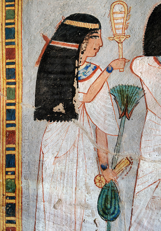 "[EGYPT 29382] 'Nebtawy in Roy's tomb at Luxor.'  	A mural detail in the tomb of Roy shows Nebtawy, Roy's wife, holding a sistrum with Hathor head, a stem of papyrus and a Menat necklace (with counterweight). Roy was an 18th dynasty royal scribe during the reign of Horemheb. His tomb (TT 255) can be found in the Necropolis of Dra Abu el-Naga on the Westbank at Luxor. It is one of the socalled ""Tombs of the Nobles"". Photo Mick Palarczyk and Paul Smit."