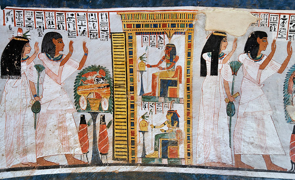 "[EGYPT 29383] 'Offerings for Nefertem and Maat in Roy's tomb at Luxor.'  	A mural detail in the tomb of Roy shows (on the left) a man and woman presenting a table with offerings to two gods in a shrine. The couple are Amenemipet and his wife Muty and their relation to Roy is unclear. They are asking for entry into the domain of the gods, which will be granted to them since the door of the shrine is open. The gods welcoming them are Nefertem (top) and Maat (below). Their wigs are dark blue to imitate the lapis-lazzuli, of which the hair of gods is supposed to be made. On the right the (same?) couple is standing in worship for another shrine (not in picture). Roy was an 18th dynasty royal scribe during the reign of Horemheb. His tomb (TT 255) can be found in the Necropolis of Dra Abu el-Naga on the Westbank at Luxor. It is one of the socalled ""Tombs of the Nobles"". Photo Mick Palarczyk and Paul Smit."
