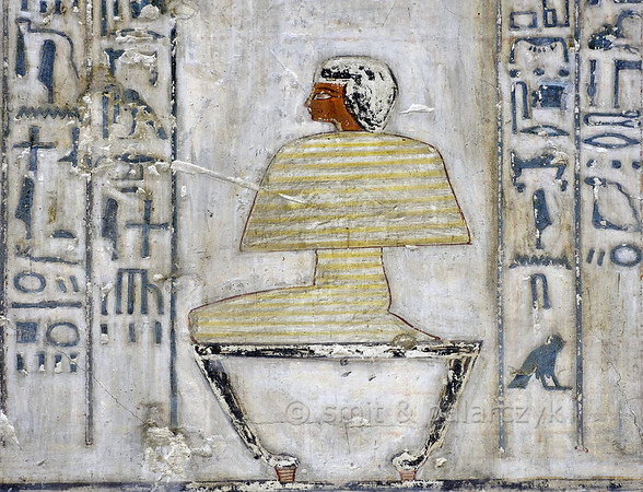 """[EGYPT 29365] 'Sem priest in Rekhmire's tomb at Luxor.'  This strange figure depicted on a wall in Rekhmire's tomb is a Sem priest wrapped up in a mummy-like shroud and placed on a chair. He has probably just awakened from a shamanic trance-like state in which he has visited the deceased in the underworld. This will help him to successfully perform the """"Opening of the Mouth"""" ceremony on the mummy of the deceased, an animation ritual which will enable it to breathe, eat and speak in the afterlife. The wrapped up Sem priest is possibly identical to the tekenu we see in other tomb murals: a human-like bundle that is transported to the tomb on a sledge. Rekhmire was an 18th dynasty vizier (viceroy) and mayor of Thebes during the reigns of Thutmosis III and Amenhotep II. His tomb (TT 100) is located in the Sheikh Abd el Qurnah Necropolis on the Westbank at Luxor and is one of the socalled """"Tombs of the Nobles"""". Photo Mick Palarczyk and Paul Smit."""