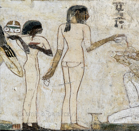 "[EGYPT 29355] 'Servant girls in Rekhmire's tomb at Luxor.'  	In Rekhmire's tomb a large painting in several registers shows his funeral banquet. This detail has the famous scene of a servant girl who is shown with her back to us in a three-quarter view that is unique in Egyptian art. Next to her is a smaller girl of Nubian descent. Rekhmire was an 18th dynasty vizier (viceroy) of Southern Egypt, mayor of Thebes and steward of the Amon Temple at Karnak during the reigns of Thutmosis III and Amenhotep II. His tomb (TT 100) is located in the Sheikh Abd el Qurnah Necropolis on the Westbank at Luxor and is one of the socalled ""Tombs of the Nobles"". Photo Mick Palarczyk and Paul Smit."