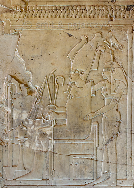 "[EGYPT 29332] Osiris and Hathor-Imentet in Khaemhat's tomb at Luxor.'  	A well crafted relief in the tomb of Khaemhat shows a seated Osiris embraced from behind by the Goddess of the West (Hathor-Imentet). She is the mistress of the west, the land of the deceased, and wears the hieroglyph for 'west' as a headdress. Khaemhat (also known as Mahu) was an 18th dynasty royal scribe and 'Overseer of the Granaries of Upper and Lower Egypt. His tomb (TT 57) is located in the Sheikh Abd el Qurnah Necropolis on the Westbank at Luxor. It is one of the socalled ""Tombs of the Nobles"" and dates to the reign of Amenhotep III. Photo Mick Palarczyk and Paul Smit."