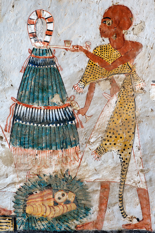 """[EGYPT 29369] 'Onions in Roy's tomb at Luxor.'  A mural detail in the tomb of Roy shows a Sem priest in a leopard skin performing a fumigation with incense and a libation in front of a large bundle of onions, tied at the top by a red and white handle. This """"bouquet"""" of onions was offered during the Feast of Onions and was meant to return the breath of life to the underworld god Sokar. Roy was an 18th dynasty royal scribe during the reign of Horemheb. His tomb (TT 255) can be found in the Necropolis of Dra Abu el-Naga on the Westbank at Luxor. It is one of the socalled """"Tombs of the Nobles"""". Photo Mick Palarczyk and Paul Smit."""
