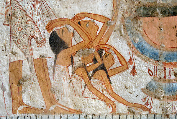 """[EGYPT 29342] 'Mourning women in Userhet's tomb at Luxor.'  A mural detail in Userhet's tomb shows women covering their heads with dust as a sign of mourning. Userhet (also called Neferhabef) was 'First Prophet of the Royal Ka (soul) of Thutmosis I' and served in the cult temple of this 18th dynasty pharaoh during the reigns of 19th dynasty pharaohs Ramses I and Seti I. His tomb (TT 51) is located in the Sheikh Abd el Qurnah Necropolis on the Westbank at Luxor and is one of the socalled """"Tombs of the Nobles"""". Originally it was one of the most beautiful tombs of the necropolis, but it was badly vandalized in 1941, leaving most figures with chiseled out eyes. Photo Mick Palarczyk and Paul Smit."""