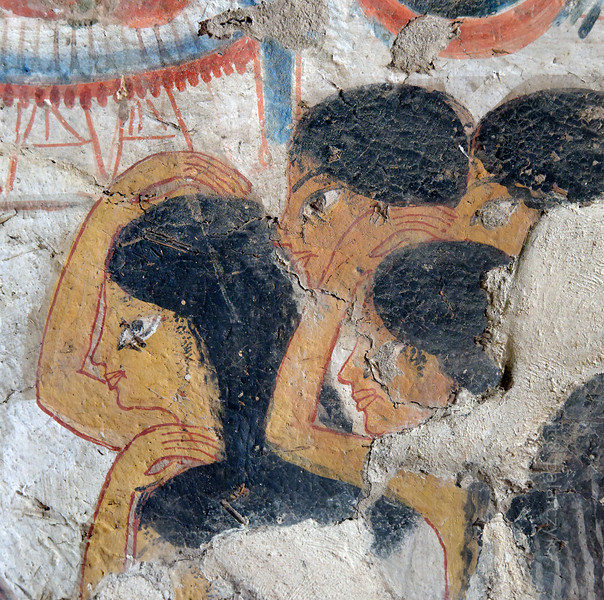 """[EGYPT 29343] 'Mourning women in Userhet's tomb at Luxor.'  A mural detail in Userhet's tomb shows women covering their heads with dust as a sign of mourning. Userhet (also called Neferhabef) was 'First Prophet of the Royal Ka (soul) of Thutmosis I' and served in the cult temple of this 18th dynasty pharaoh during the reigns of 19th dynasty pharaohs Ramses I and Seti I. His tomb (TT 51) is located in the Sheikh Abd el Qurnah Necropolis on the Westbank at Luxor and is one of the socalled """"Tombs of the Nobles"""". Originally it was one of the most beautiful tombs of the necropolis, but it was badly vandalized in 1941, leaving most figures with chiseled out eyes. Photo Mick Palarczyk and Paul Smit."""