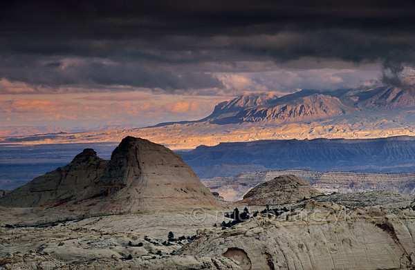 [USA.UTAH 28208] 'Lunar landscape in Capitol Reef.'  	Longleaf Flat, a plateau just north of Fruita in Capitol Reef National Park, resembles a white lunar landscape. On the horizon the northern edge of the Henry Mountains catches the last sunlight of the evening. Photo Mick Palarczyk.