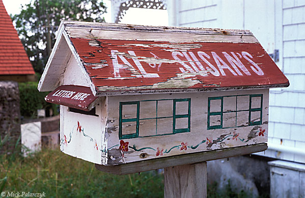 [ANTILLES.SABA 25.482] 'Letter box.'	 This letterbox in Windwardside is in the form of a typical red roofed Saba cottage. Photo Mick Palarczyk.