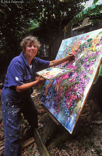 [ANTILLES.SABA 25.502] 'Heleen Cornet.'	 Artist Heleen Cornet has been living on Saba since 1986. She draws her inspiration from the island's landscapes, local people and vibrant colours. She also is the owner of the Ecolodge, an ecological oriented accommodation in the rain forest of Mt.Scenery. Photo Mick Palarczyk.