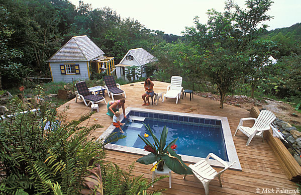 [ANTILLES.SABA 25.489] 'Ecolodge.'	 At the Ecolodge, an ecological oriented accommodation in the rain forest of Mt.Scenery's southern slope, the simple wooden cottages are grouped round a small swimming pool. Photo Mick Palarczyk.
