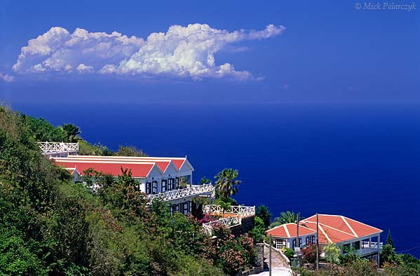[ANTILLES.SABA 25.509] 'Hotel with a view'.	 The Gate House Hotel in Hell's Gate is perched on the eastern slope of Mt. Scenery, high above the Atlantic Ocean. Photo Mick Palarczyk.