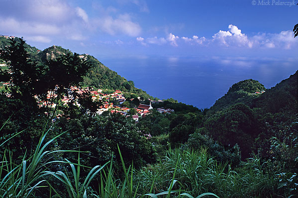 [ANTILLES.SABA 25.467] 'Windwardside.'	 Windwardside lies wedged between Booby Hill (left) and the southern slope of Mt. Scenery. Photo Mick Palarczyk.