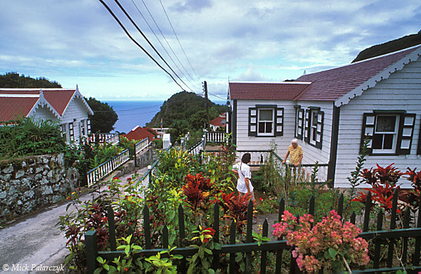 [ANTILLES.SABA 25.469] 'Floral Cottage.'	 The historic core of Windwardside with Floral Cottage in the foreground. Saba's village architecture has been highly influenced by the Irish, Scottish and English colonists who settled there starting in the 17th century. They brought with them wooden cottages typical of the English countryside. Photo Mick Palarczyk.