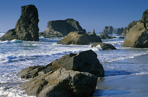 [USA.OREGON 28806] 'Sea stacks at Bandon.'  	The basalt sea stacks of Bandon look like a surrealist chess set cast upon the waters of the Pacific. Photo Mick Palarczyk.