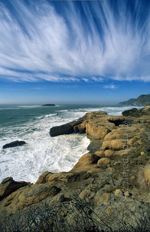 [USA.OREGON 28768] 'Pacific coast near Devil's Punchbowl.'  The Pacific coast near Devil's Punchbowl, 15 km north of Newport, consists of sandstone cliffs. Photo Mick Palarczyk.