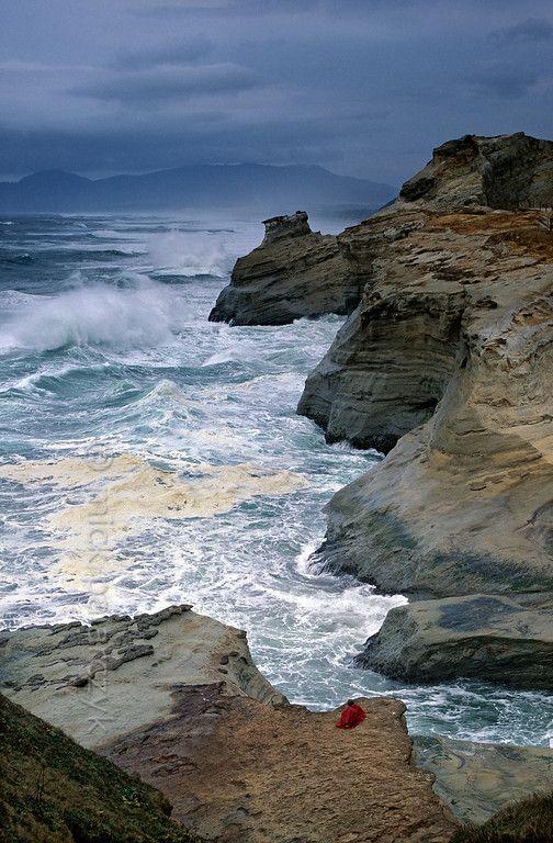 [USA.OREGON 28767] 'Cape Kiwanda.'  The sandstone escarpment of Cape Kiwanda, just north of Pacific City, is a good place to experience spectacular wave action if seas are rough. Photo Mick Palarczyk.