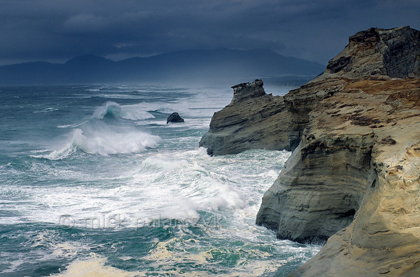 [USA.OREGON 28765] 'Cape Kiwanda.'  The sandstone escarpment of Cape Kiwanda, just north of Pacific City, is a good place to experience spectacular wave action if seas are rough. Photo Mick Palarczyk.