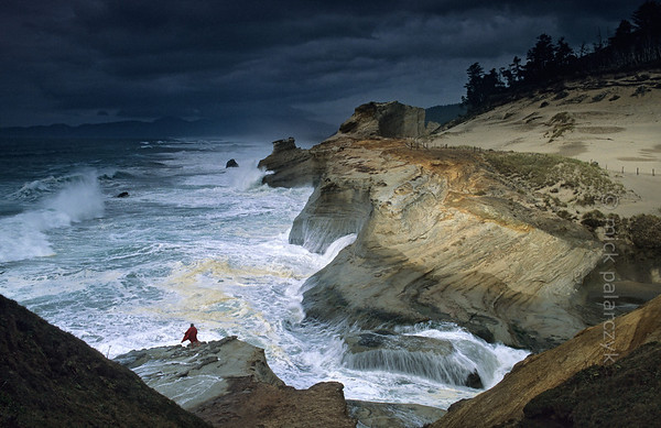 [USA.OREGON 28766] 'Cape Kiwanda.'  The sandstone escarpment of Cape Kiwanda, just north of Pacific City, is a good place to experience spectacular wave action if seas are rough. Photo Mick Palarczyk.
